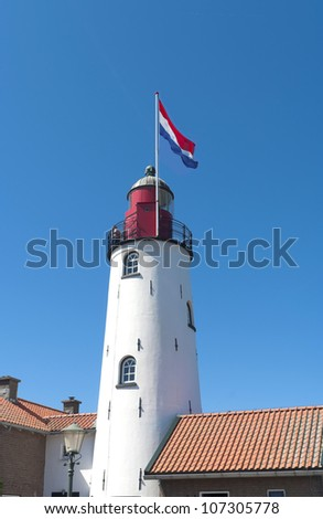 lighthouse of Urk, a typical dutch fishing village - stock photo