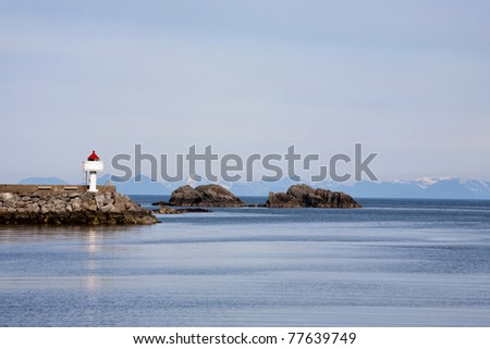 Lighthouse on a pier - stock photo