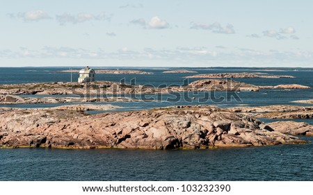 Lighthouse on a small island in the archipelago of the Aland Islands, Finland - stock photo