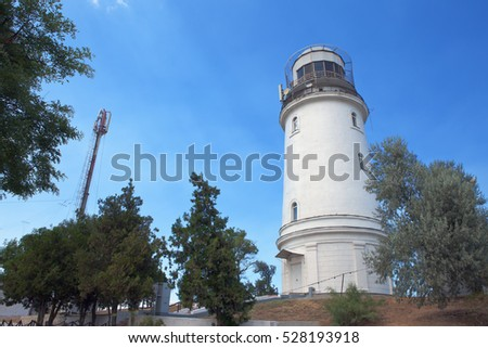 Lighthouse on blue sky background