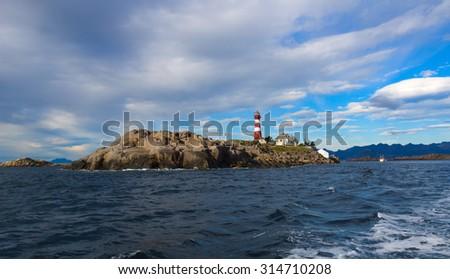 Lighthouse on norwegian island Skrova - stock photo