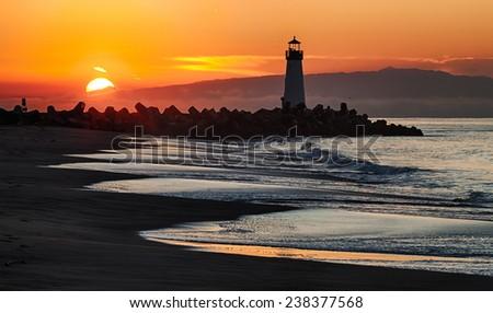 Lighthouse on Santa Cruz Shore - stock photo