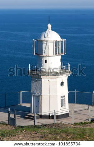 lighthouse on sea - stock photo
