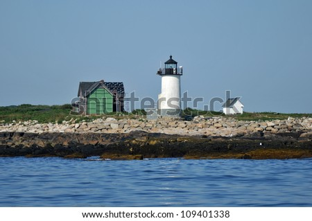Lighthouse on Straightsmouth Island off Rockport, Massachusetts, viewed from the water - stock photo