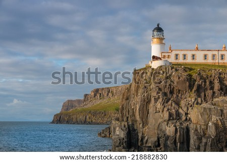Lighthouse on the cliffs of Neist Point, a famous landmark near Glendale, Isle of Skye, Scotland - stock photo