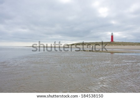 Lighthouse on the coast of the netherlands  - stock photo