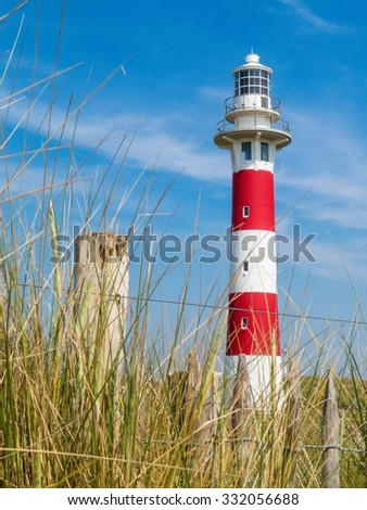 Lighthouse on the coast of the North Sea in a sunny day, Belgium - stock photo