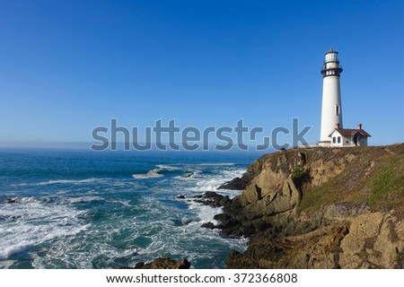 Lighthouse on the edge of a cliff.Pacific ocean. Route 1, California, US.