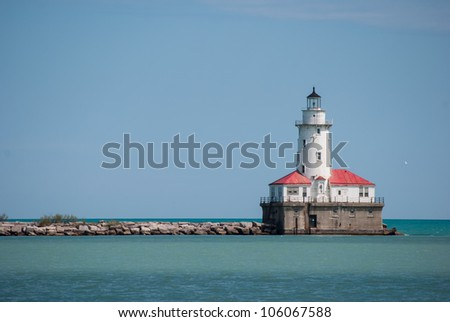 Lighthouse on the edge of water