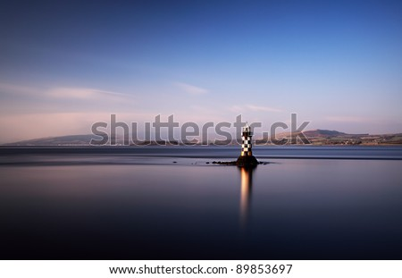 Lighthouse on the firth of Clyde - stock photo