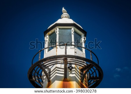 Lighthouse on the Smeatons Pierin the bay in St. Ives, Cornwall, England, UK, Europe - stock photo