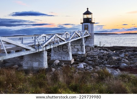 Lighthouse on top of a rocky island in Maine  - stock photo