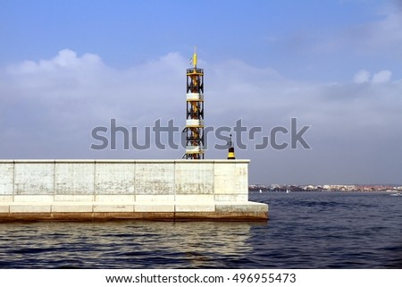 Lighthouse over the breakwater in the north side of Valencia harbor