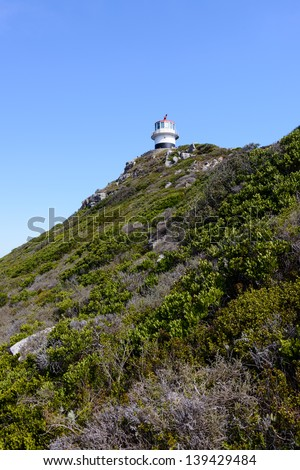 Lighthouse over the rock in South Africa - stock photo