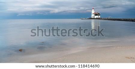 Lighthouse Paard van Marken at sunset, North Holland, Netherlands - stock photo
