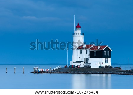 Lighthouse Paard van Marken at twilight, North Holland, Netherlands - stock photo