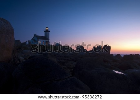 Lighthouse Pontusval after sunset at the coast, Brittany, France,