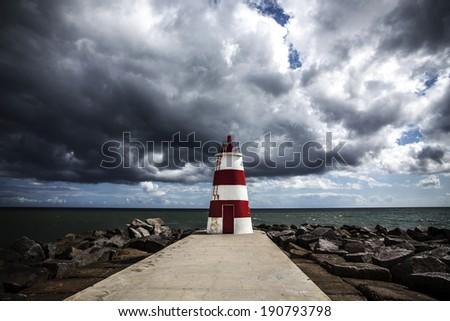 lighthouse portimao, Algarve Portugal - stock photo