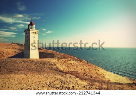 Lighthouse Rubjerg Knude and sand dunes at the danish North Sea coast, vintage style, Denmark, Europe  - stock photo
