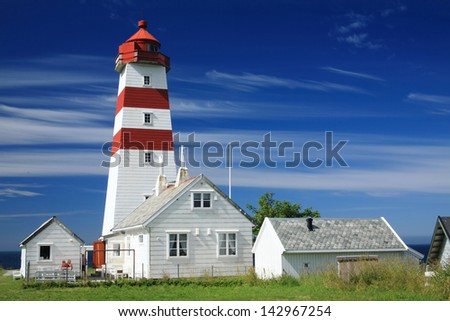 lighthouse runde nature reserve island of seabirds bridge typical fishermen's houses become housing for eco tourists coastal landscape of northern europe norway - stock photo
