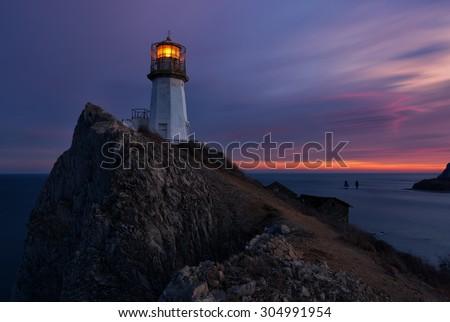 Lighthouse. Seascape. Russian Far East. Japan (East) Sea. - stock photo