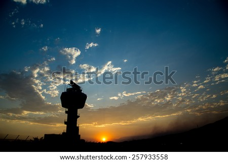 lighthouse silhouette and twilight sky sunset - stock photo