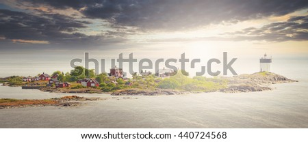 Lighthouse Svartklubben in Grisslehamn from above in a extreme panorama view. - stock photo