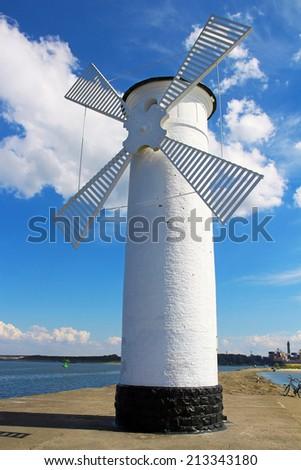 Lighthouse windmill in Swinoujscie, Baltic Sea, Poland  - stock photo