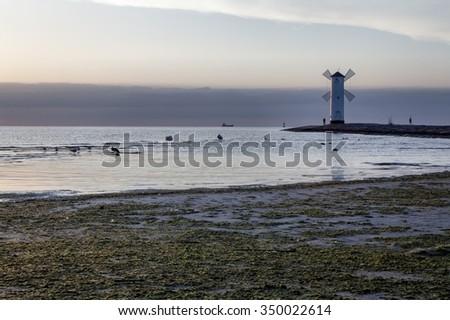 Lighthouse windmill Stawa Mlyny, Swinoujscie, Baltic Sea, Poland. - stock photo