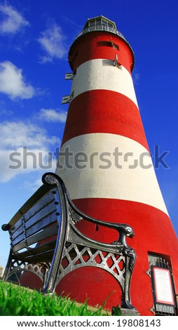 lighthouse with a bench, Plymouth, UK - stock photo