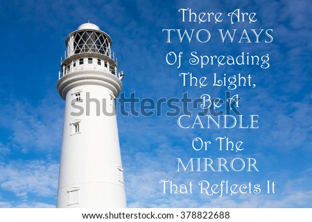 Lighthouse with a Inspirational motivational quote.of There Are Two Ways Of Spreading The Light, Be A Candle Or The Mirror To Reflect It against a partly cloudy sky background - stock photo