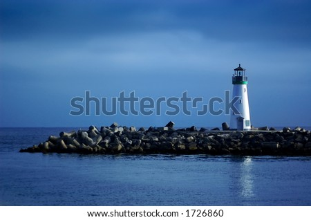 Lighthouse with blue sky - stock photo