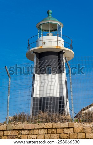 Lighthouse with blue sky on the background