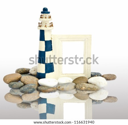 lighthouse wooden frame with reflection. - stock photo