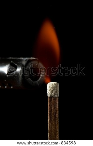 Lighting a match - stock photo