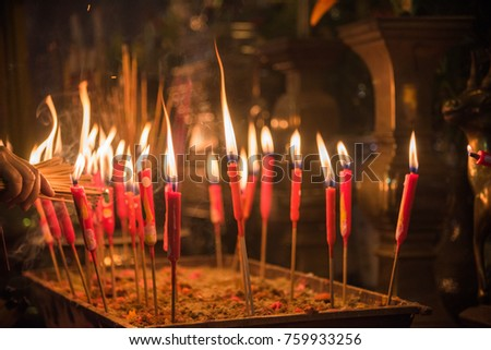Lighting an incense stick with taper candle in the famous Kwun Yam Temple in Hong Kong & Lighting Incense Stick Taper Candle Famous Stock Photo (Edit Now ...
