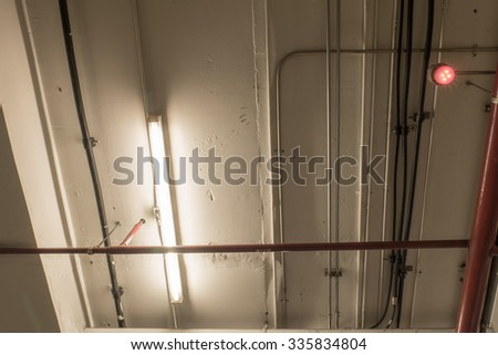 Lighting and various pipes. - stock photo