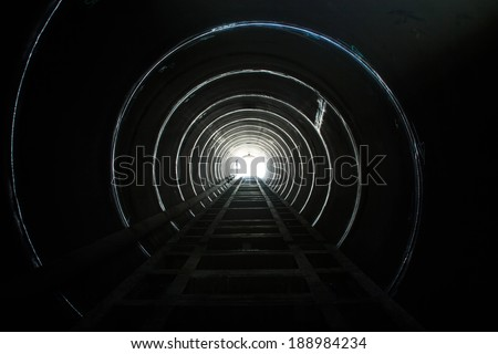 Lighting at the end of the tunnel. - stock photo