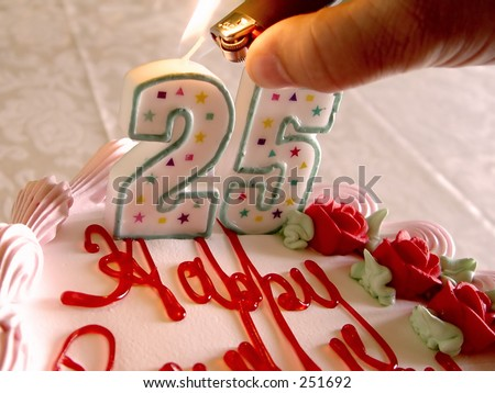 Lighting Birthday Candles for someone who is twenty five years old - stock photo
