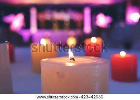 Lighting candle in the night wedding party - stock photo