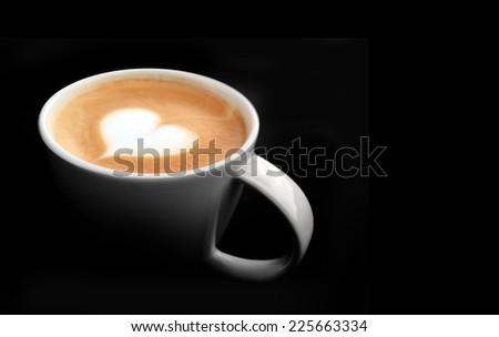 lighting cup of latte art coffee on dark background - stock photo