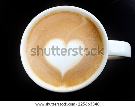 lighting cup of latte art coffee on dark background - stock photo