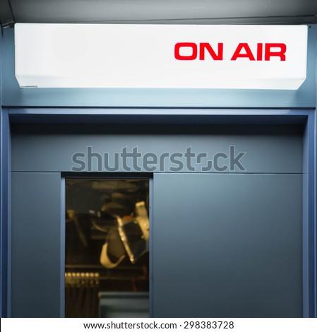 lighting of on air signboard in TV studio lightin is background - stock photo