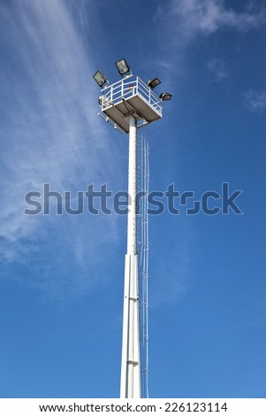 Lighting tower against a clear blue sky - stock photo
