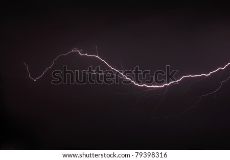 Lightning a thunderstorm, nightly cloudy sky, background