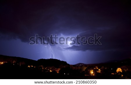 lightning above village - stock photo