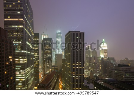 Lightning across the New York City skyline on a foggy night.