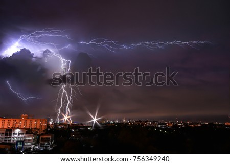 Lightning and storm over building in city