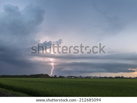 Lightning and thunderstorm over the fields - stock photo