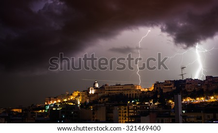 Lightning behind the old city
